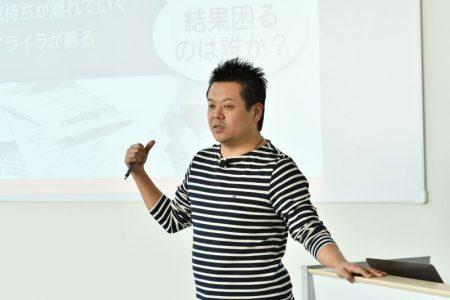 写真:登壇中の名村さん。説明に納得です。